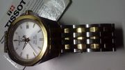 Gold & Silver TISSOT watch.